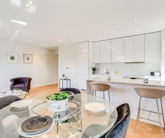 Open concept, newly renovated kitchen with Quartz countertops and an integrated fridge and dishwasher, The Century