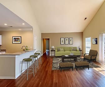 living room with parquet floors, lofted ceiling, a breakfast bar area, range oven, and microwave, Christopher Wren Apartments