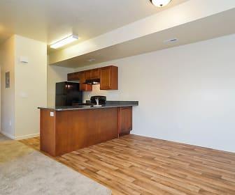 kitchen featuring exhaust hood, refrigerator, range oven, stone countertops, light parquet floors, and dark brown cabinets, SITE Layton