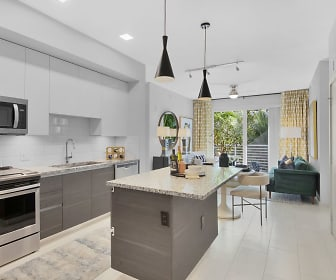 kitchen with a center island, stainless steel microwave, electric range oven, dishwasher, dark brown cabinets, light stone countertops, pendant lighting, and light tile flooring, Aura Boca