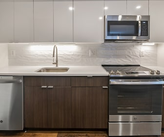 kitchen with electric range oven, stainless steel appliances, white cabinets, light countertops, and dark floors, Park at Pentagon Row