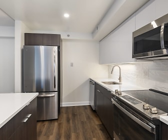 kitchen with electric range oven, stainless steel appliances, dark brown cabinetry, light countertops, and dark hardwood flooring, Park at Pentagon Row
