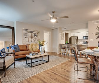 hardwood floored living room with a breakfast bar, a ceiling fan, stainless steel refrigerator, range oven, and microwave, Knox at Allen Station