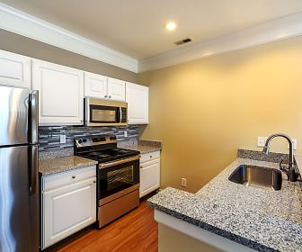 kitchen featuring electric range oven, stainless steel appliances, white cabinets, dark granite-like countertops, and light hardwood floors, Christopher Wren Apartments