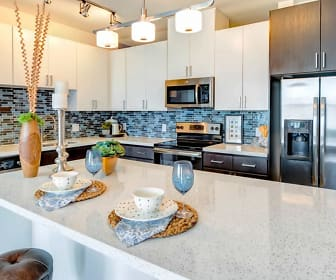 kitchen with stainless steel appliances, electric range oven, white cabinetry, pendant lighting, and light countertops, VELA at Town Lake