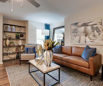 hardwood floored living room featuring natural light, Knox at Allen Station