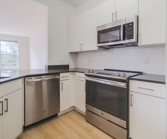 kitchen with natural light, electric range oven, stainless steel appliances, light hardwood floors, and white cabinetry, The Landings at Port Imperial