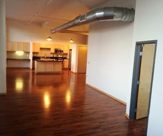corridor with parquet floors, microwave, and range oven, Boston Lofts