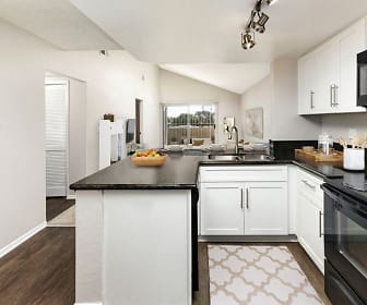 kitchen with natural light, electric range oven, microwave, dark parquet floors, dark granite-like countertops, and white cabinetry, Camden Sea Palms