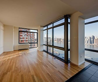 empty room featuring plenty of natural light and hardwood floors, Avalon Riverview