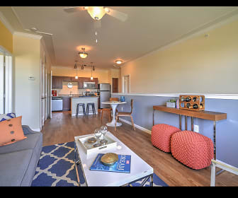 living room with a ceiling fan, parquet floors, refrigerator, and dishwasher, The Lodge at Heritage Lakes