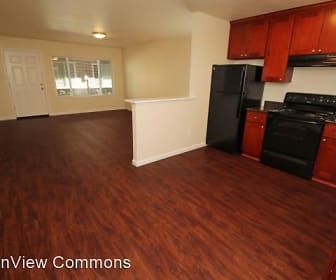 kitchen featuring range oven, refrigerator, fume extractor, dark hardwood floors, dark granite-like countertops, and brown cabinetry, TownView Commons