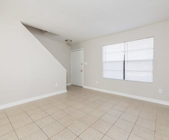 empty room with natural light and tile floors, Country Club Apartments