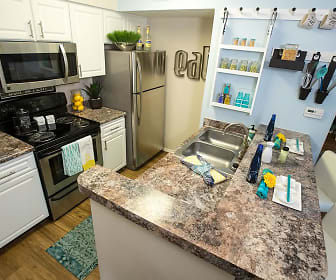 Newly renovated kitchens with wood-style flooring, granite-style counter tops, and full sized pantries., River Bluff of Lexington