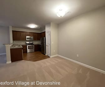 kitchen with carpet, refrigerator, microwave, range oven, light floors, light stone countertops, and dark brown cabinetry, Wexford Village at Devonshire