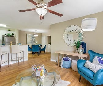 living room featuring a kitchen breakfast bar, a ceiling fan, and refrigerator, Lexington Palms at the Forum