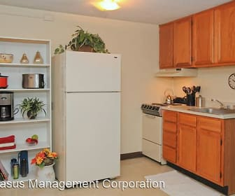 kitchen featuring refrigerator, range oven, exhaust hood, light countertops, light tile floors, and brown cabinets, Fox Park Apartments