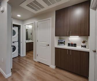 hallway showing washer/dryer and storage, Talavera