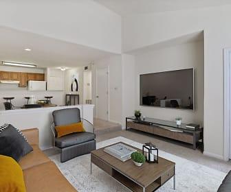 living room featuring carpet, refrigerator, and TV, Camden Russett