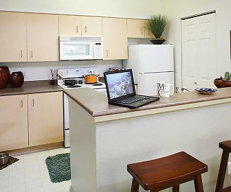kitchen with microwave, refrigerator, electric range oven, white cabinets, and light tile floors, Avalon at Bear Creek