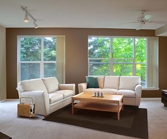 carpeted living room featuring a ceiling fan, plenty of natural light, and TV, Avalon ParcSquare