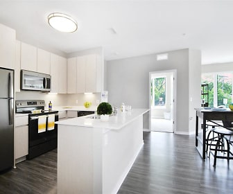 kitchen with a kitchen island, a healthy amount of sunlight, electric range oven, stainless steel appliances, light countertops, white cabinetry, and dark hardwood floors, The George