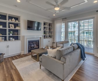 hardwood floored living room featuring a ceiling fan, a fireplace, natural light, and TV, Eldridge Townhomes