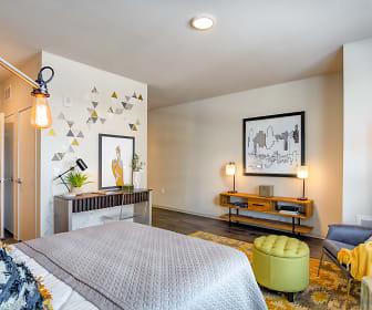 bedroom featuring hardwood floors, The Link Minneapolis