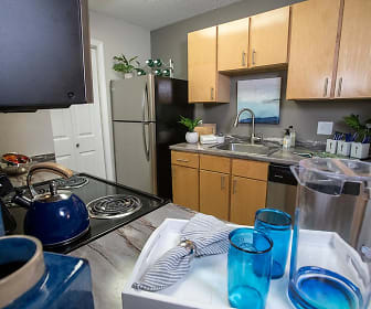 Kitchens featuring wood-style flooring, amble cabinetry, and a laundry room., The Sound at St. Martin