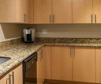 kitchen with refrigerator, dishwasher, electric range oven, granite-like countertops, and brown cabinetry, Avalon Grosvenor Tower