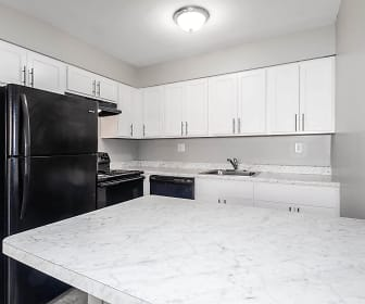 kitchen with refrigerator, electric range oven, dishwasher, light granite-like countertops, and white cabinetry, International City Villas/Mews