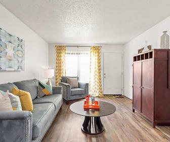 Living Room View with Hardwood Floors and Large Window - Raindance Apartments, Raindance