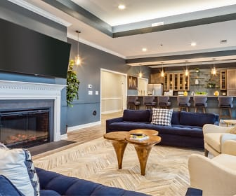 Fireplace, TV and seating at the Residents Clubhouse, Crossroads Station Apartments