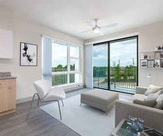 living room with a wealth of natural light, a ceiling fan, and hardwood floors, The Lofts at South Lake