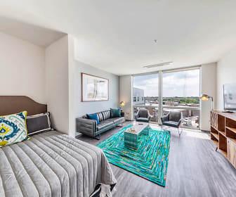 bedroom featuring parquet floors, natural light, and TV, Noca Blu
