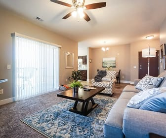 carpeted living room with natural light and a ceiling fan, The Mirada