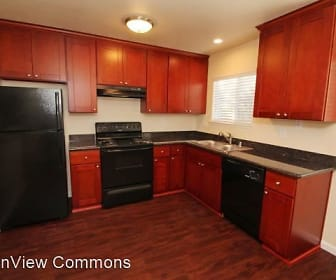 kitchen with refrigerator, dishwasher, range oven, fume extractor, dark parquet floors, dark stone countertops, and brown cabinets, TownView Commons
