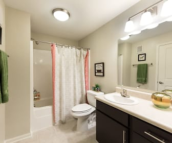 full bathroom featuring tile floors, mirror, toilet, shower / bathing tub combination, vanity, and shower curtain, 3 Springs Apartments