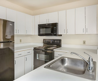 kitchen featuring refrigerator, electric range oven, microwave, white cabinets, and light countertops, Bigelow Commons