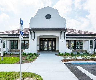 mediterranean / spanish-style house featuring a front yard, Estero Parc Apartments