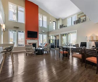 building lobby featuring a wealth of natural light, hardwood flooring, a fireplace, and TV, The Arbours of Hermitage