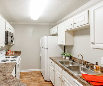 kitchen with refrigerator, electric range oven, microwave, stone countertops, white cabinetry, and light hardwood flooring, Avalon Of Hermitage