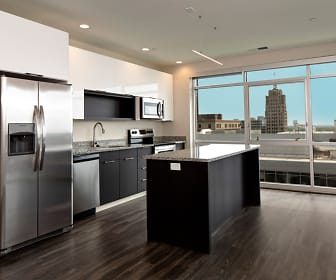Apartment unit kitchen with views of Downtown Fort Wayne, Skyline Tower