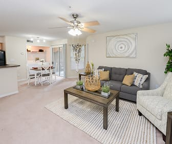 living room with carpet, a ceiling fan, and refrigerator, The Promenade