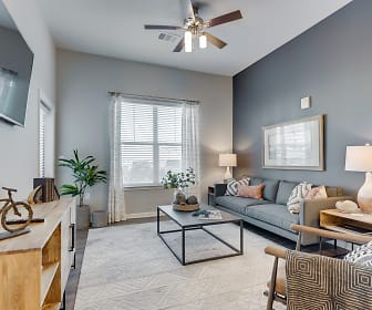 living room featuring natural light, a ceiling fan, and TV, The Wyatt by Watermark