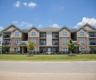 view of building exterior with a lawn, South Park Village Apartments