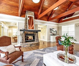 living room featuring hardwood flooring, a fireplace, and lofted ceiling with beams, Reserve at Mill Landing
