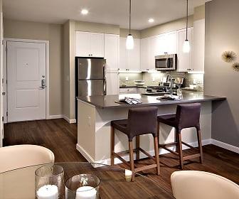 kitchen featuring a kitchen breakfast bar, stainless steel appliances, range oven, white cabinets, dark hardwood flooring, pendant lighting, and dark countertops, Avalon Quincy