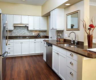 kitchen featuring range hood, refrigerator, electric stovetop, stainless steel dishwasher, white cabinetry, dark hardwood floors, and dark countertops, Avalon Bear Hill