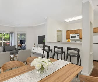 hardwood floored dining room featuring natural light, a breakfast bar area, refrigerator, TV, and microwave, Camden Largo Town Center